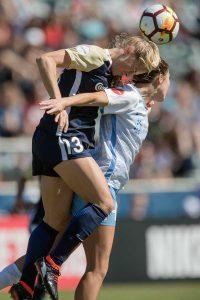 Abby Dahlkemper (13) and Katie Johnson vie for the ball. (Shane Lardinois)