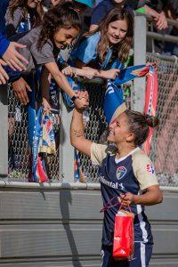 Debinha greeting fans after the match. (Shane Lardinois)