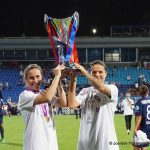 Camille Abily and Dzsenifer Marozsán lift the Champions League trophy after defeating Wolfsburg, 4-1. (Daniela Porcelli)