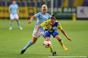Izzy Christiansen battles Stefanie Enzinger in Champions League action. (Granada, WikiCommons)