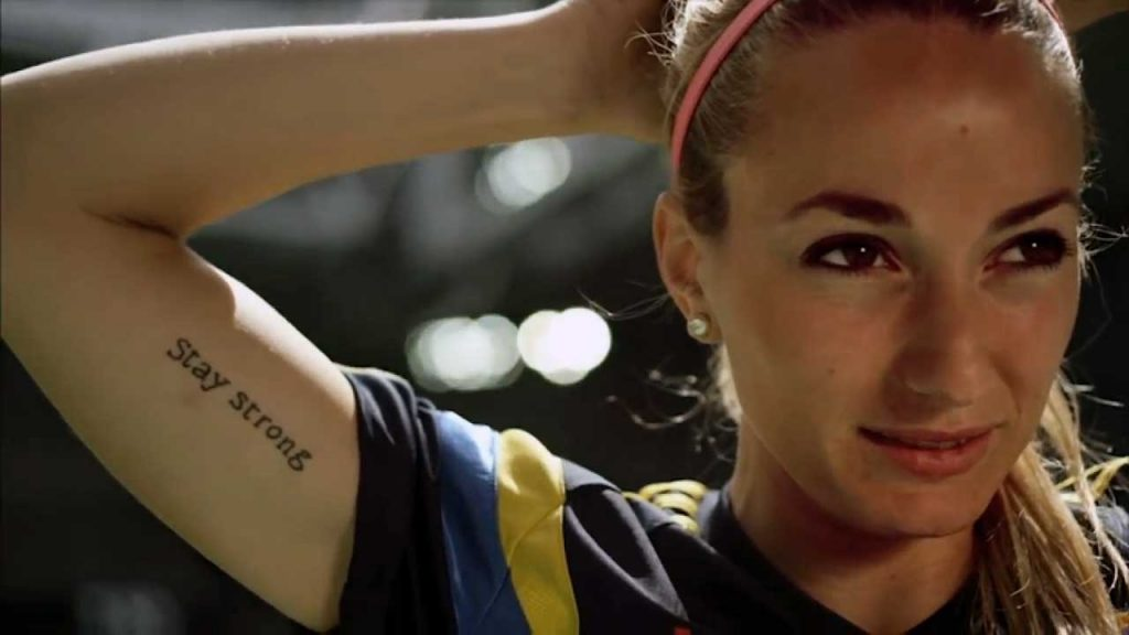 Kosovare Asllani close up with tatto of Stay Strong.