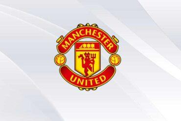 Manchester United logo on white background.