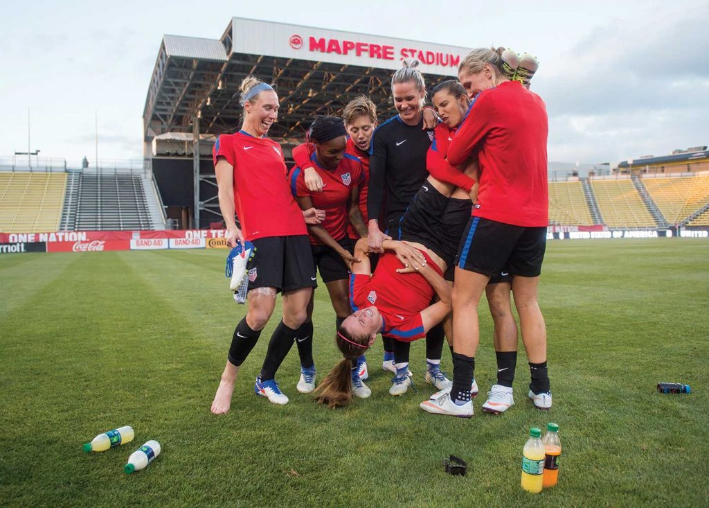 Members of the U.S. WNT playing around after practice. Full version. (Brad Smith / ISI)