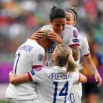 Shanice van de Sanden, Dzsenifer Marozsán, and Ada Hegerberg celebrate during the 2019 UEFA Women's Champions League final. (Daniela Porcelli / OGM)