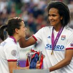 Lyon's Dzsenifer Marozsán and Wendie Renard with the Champions League trophy. (Daniela Porcelli / OGM)