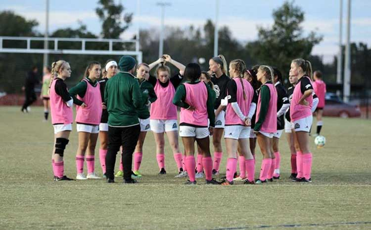 Players from Columbia State Community College in a huddle during training. (Buffy Holt)