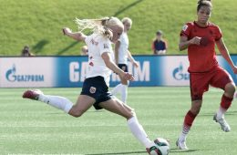 Norway's Maria Thorisdottir takes on Germany's Celia Sasic. (Andre Ringuette / Getty Images North America)