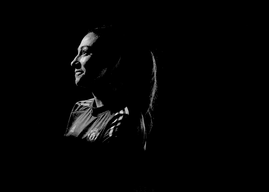 Christen Press in black-and-white silhouette wearing Manchester United kit. (Manchester United)