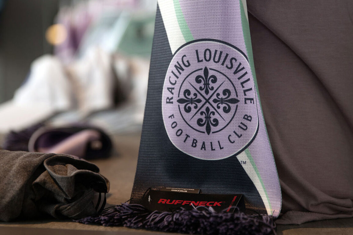 Close-up color image of Racing Louisville FC scarf. (EM Dash Photography / Racing Louisville FC)
