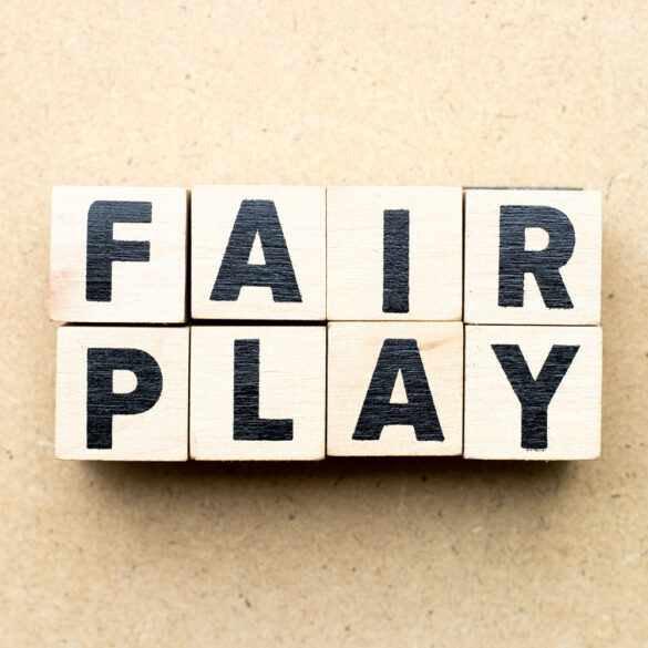 """""""Fair Play"""" spelled out in wooden blocks."""
