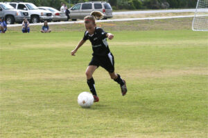 Martha Thomas with the ball as a young soccer player. (Thomas family)